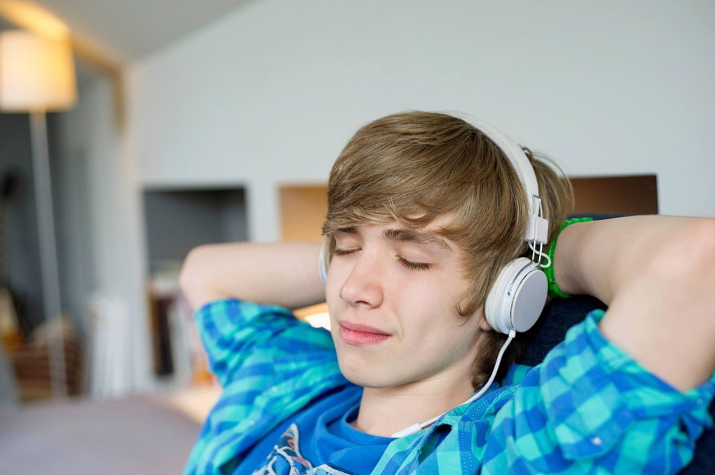 Teenage boy listening to music : Stock Photo