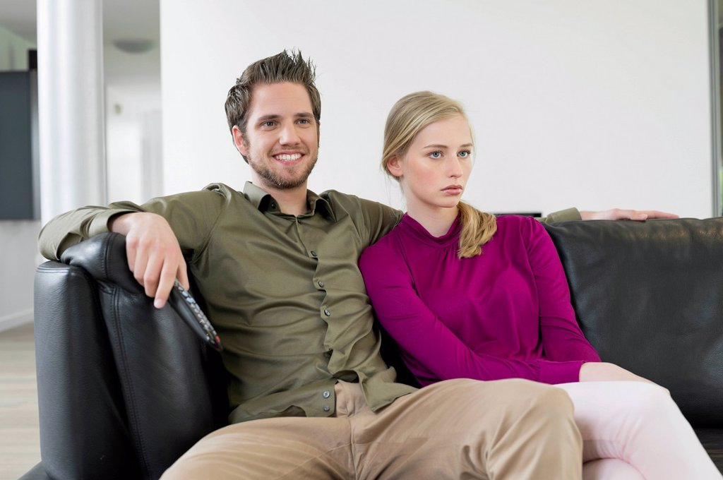 Stock Photo: 1738R-24696 Couple watching television