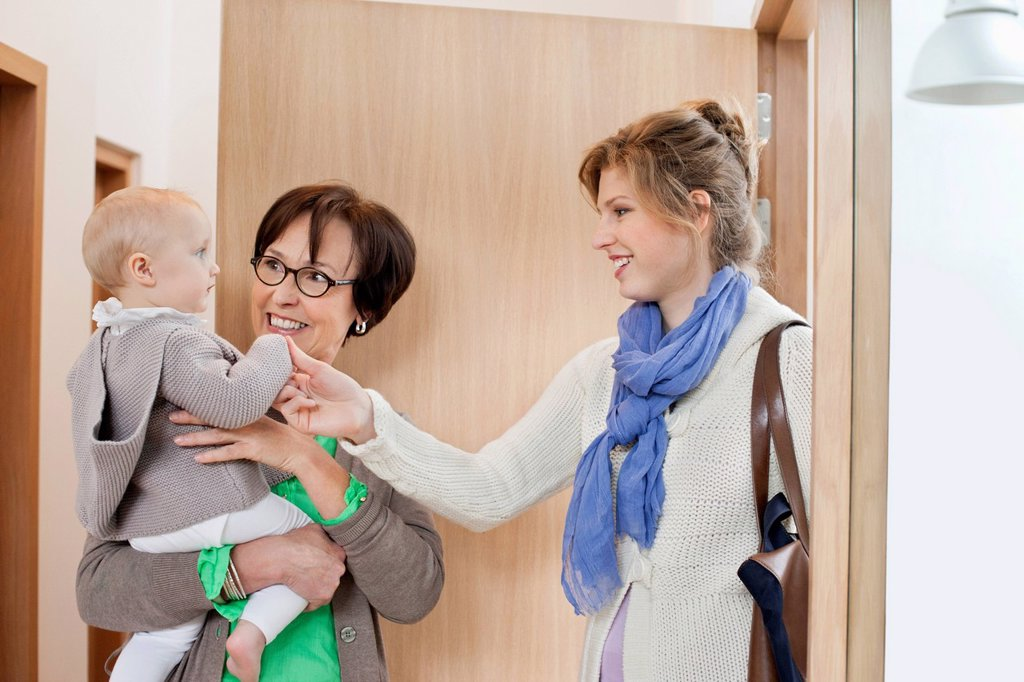 Woman loving her daughter at home arrival : Stock Photo