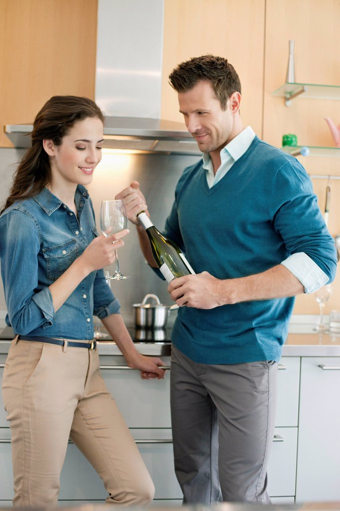 Couple drinking wine in the kitchen : Stock Photo