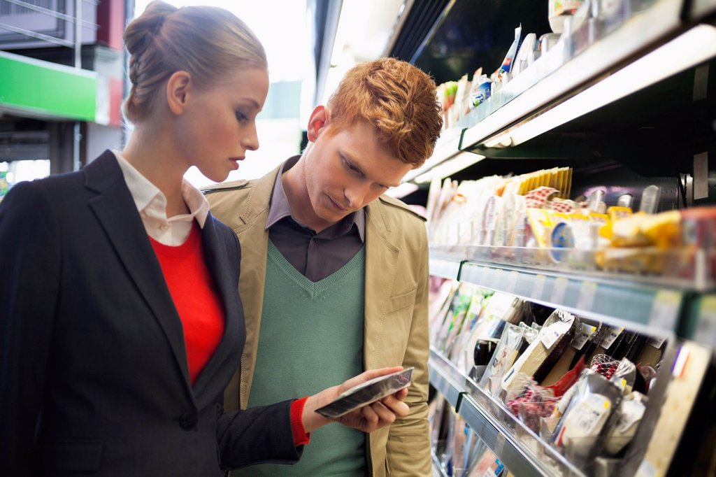 Stock Photo: 1738R-26046 Couple shopping in a supermarket