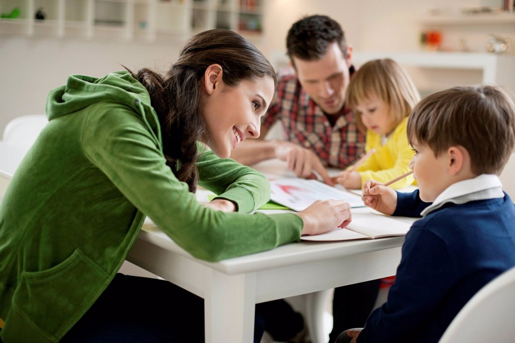 Stock Photo: 1738R-26062 Couple teaching their children at home
