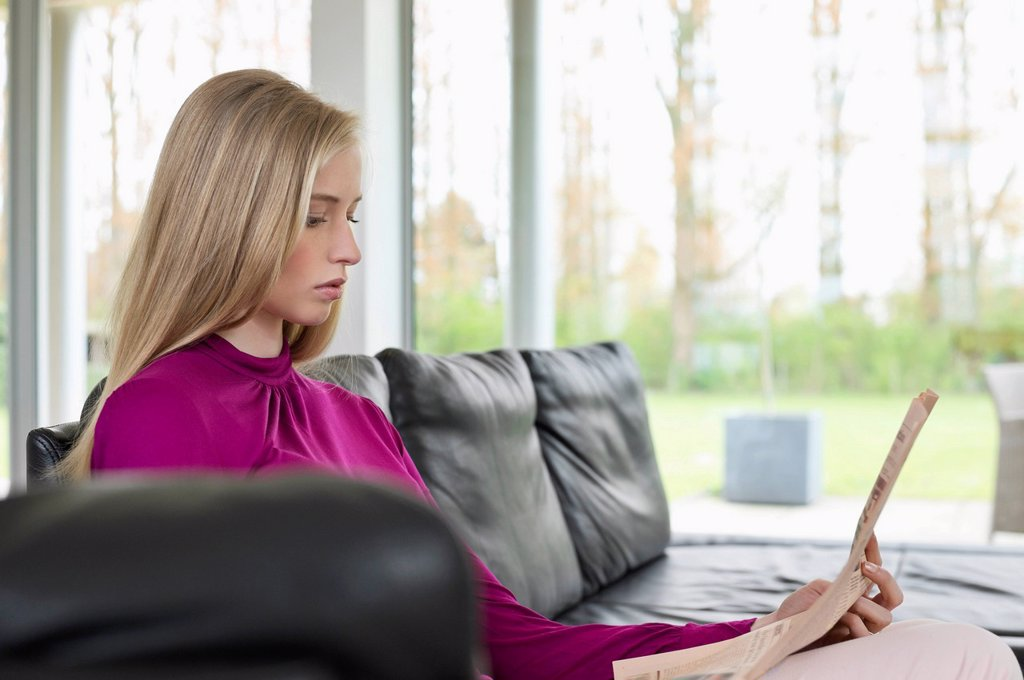Stock Photo: 1738R-26117 Woman reading a newspaper