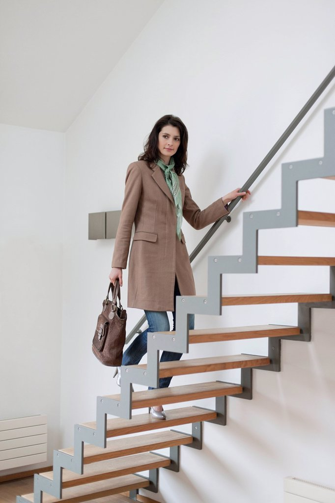 Woman moving up stairs : Stock Photo