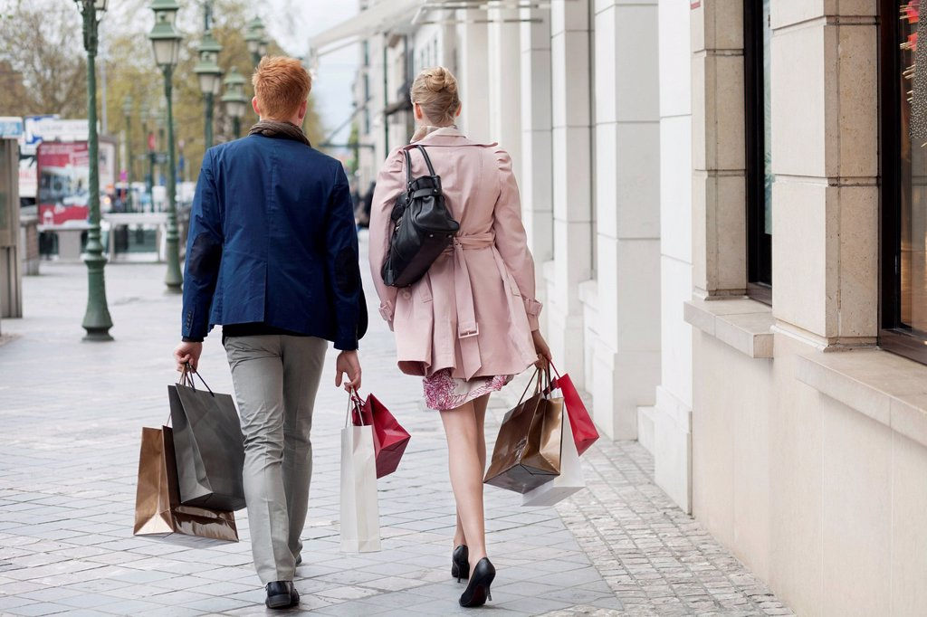 Stock Photo: 1738R-26703 Rear view of a couple carrying shopping bags