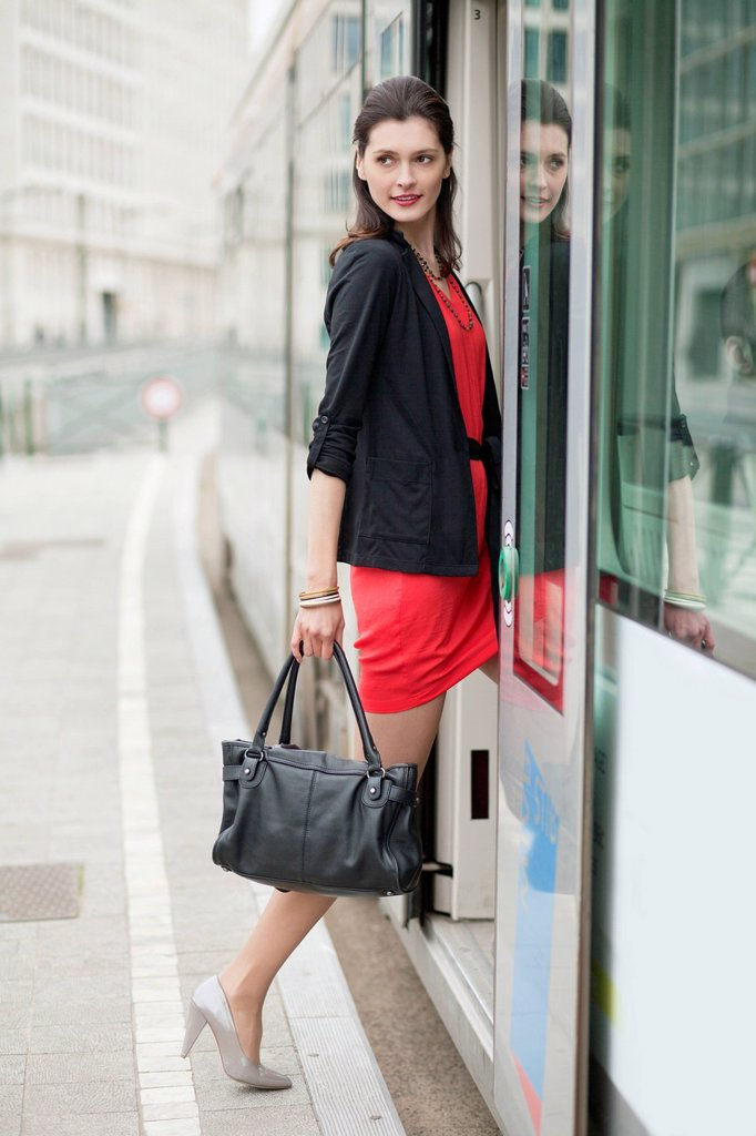 Stock Photo: 1738R-26773 Woman boarding a bus