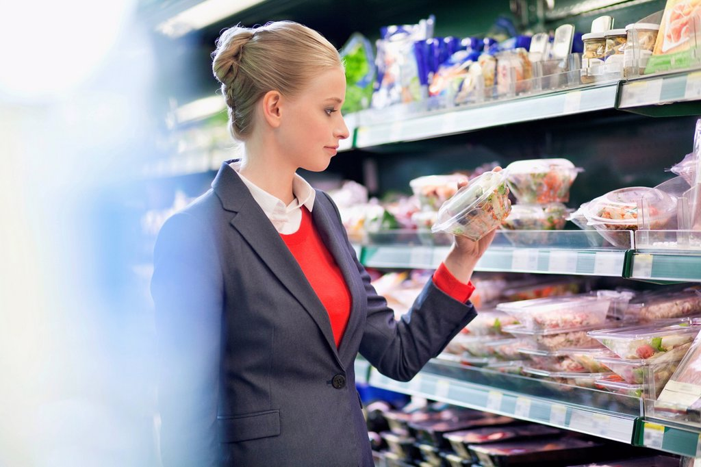 Stock Photo: 1738R-26774 Woman shopping in a supermarket