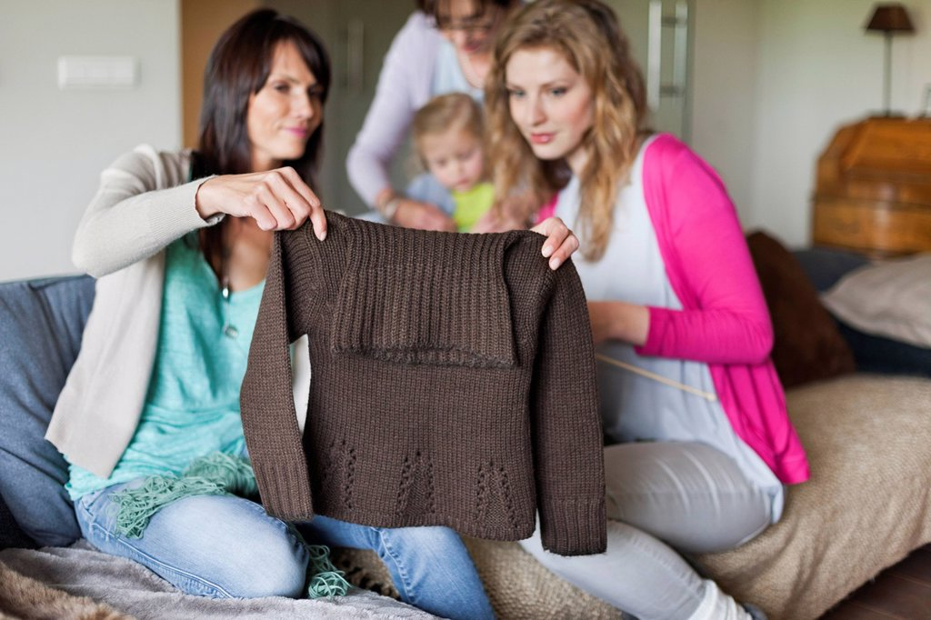 Stock Photo: 1738R-26784 Woman and her daughter looking a sweater