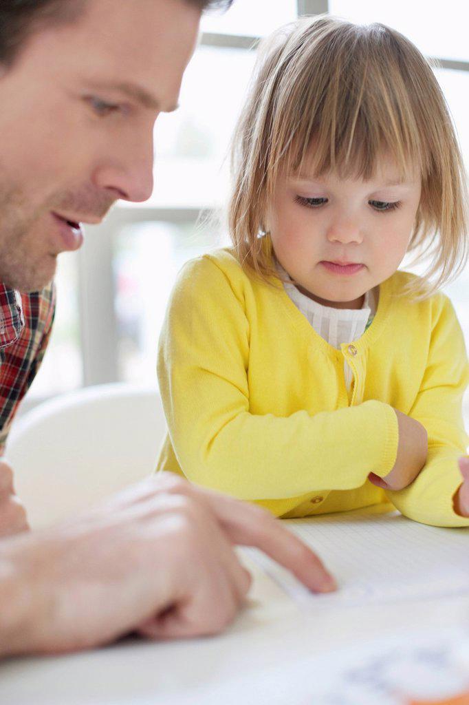 Man teaching his daughter : Stock Photo