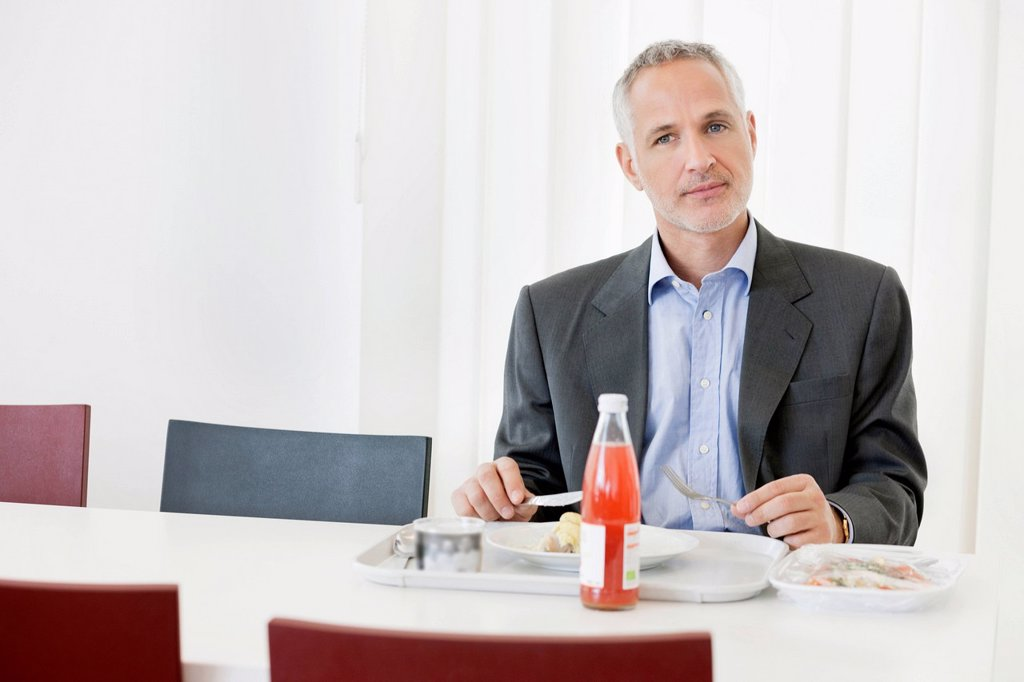 Stock Photo: 1738R-26821 Businessman having lunch in the office