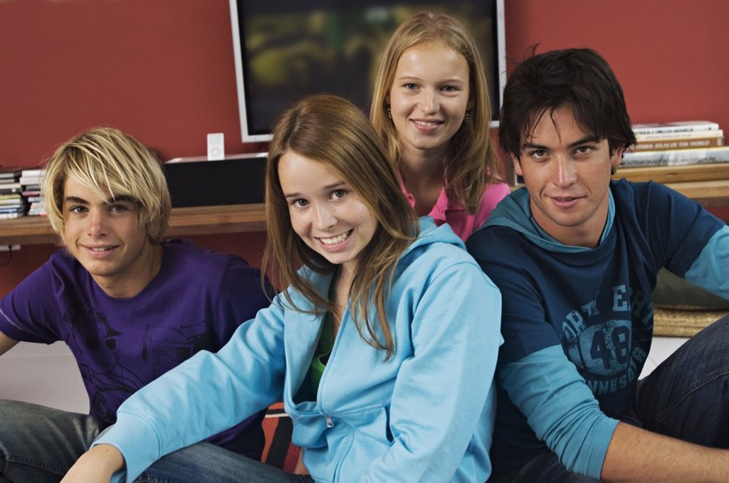 Stock Photo: 1738R-3144 2 teenage boys and 2 teenage girls smiling for camera