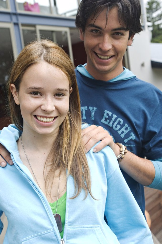 Teenage boy and girl smiling for the camera : Stock Photo