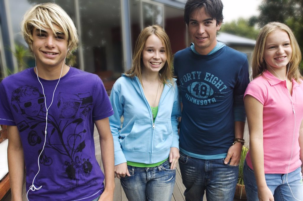 Stock Photo: 1738R-3154 2 teenage boys and 2 teenage girls smiling for camera