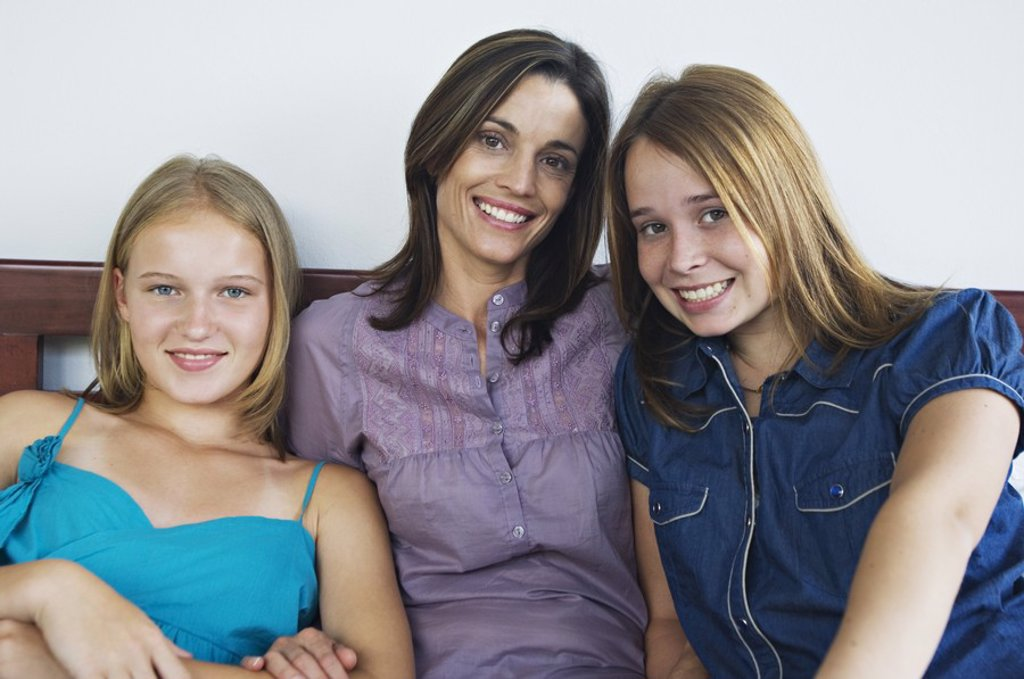 Stock Photo: 1738R-3162 2 teenage girls and a woman smiling for the camera
