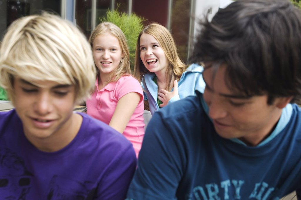 Stock Photo: 1738R-3164 2 teen girls and 2 teen boys smiling, outdoors