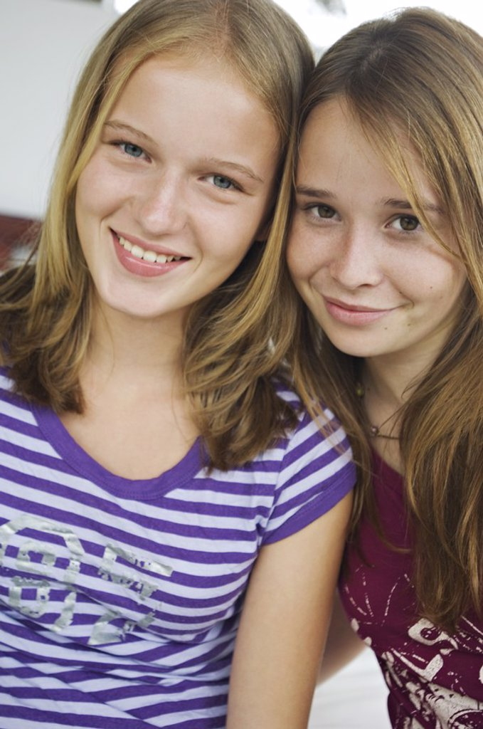 Stock Photo: 1738R-3165 Portrait of 2 smiling teenage girls