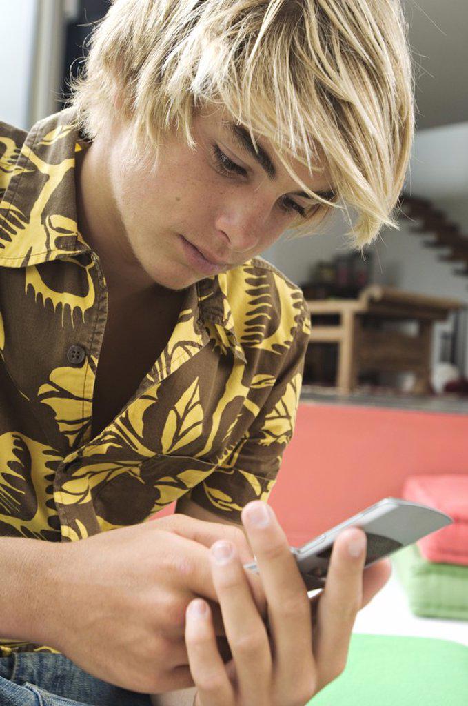 Stock Photo: 1738R-3167 Teenage boy using mobile phone
