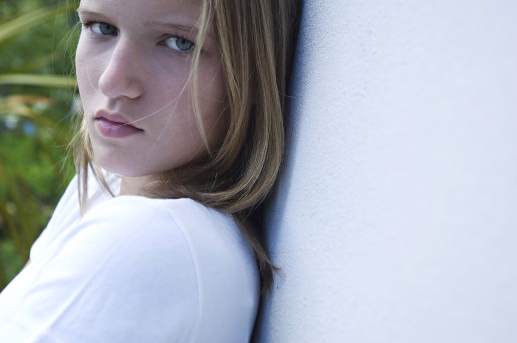 Stock Photo: 1738R-3175 Portrait of a sulking teenage girl