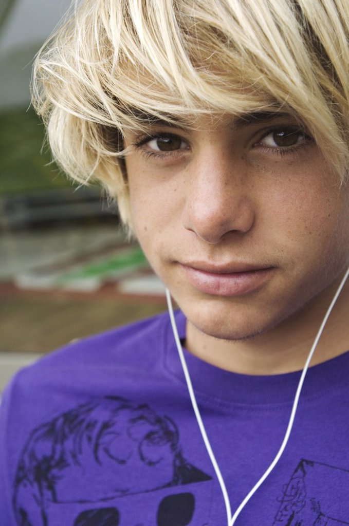 Stock Photo: 1738R-3177 Portrait of a teenage boy with earphones