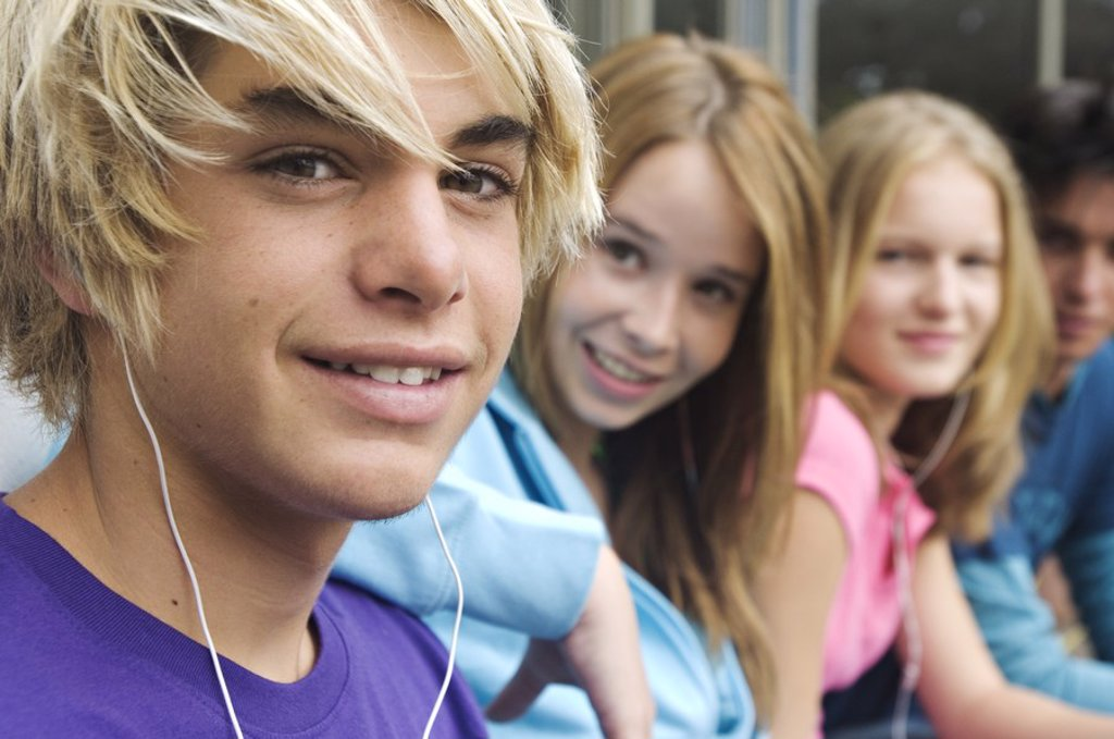 Stock Photo: 1738R-3188 2 teenage boys and 2 teenage girls smiling for camera
