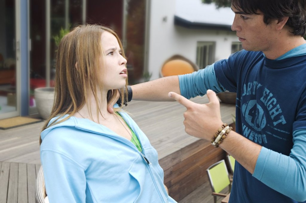 Teenage boy scolding teenage girl : Stock Photo
