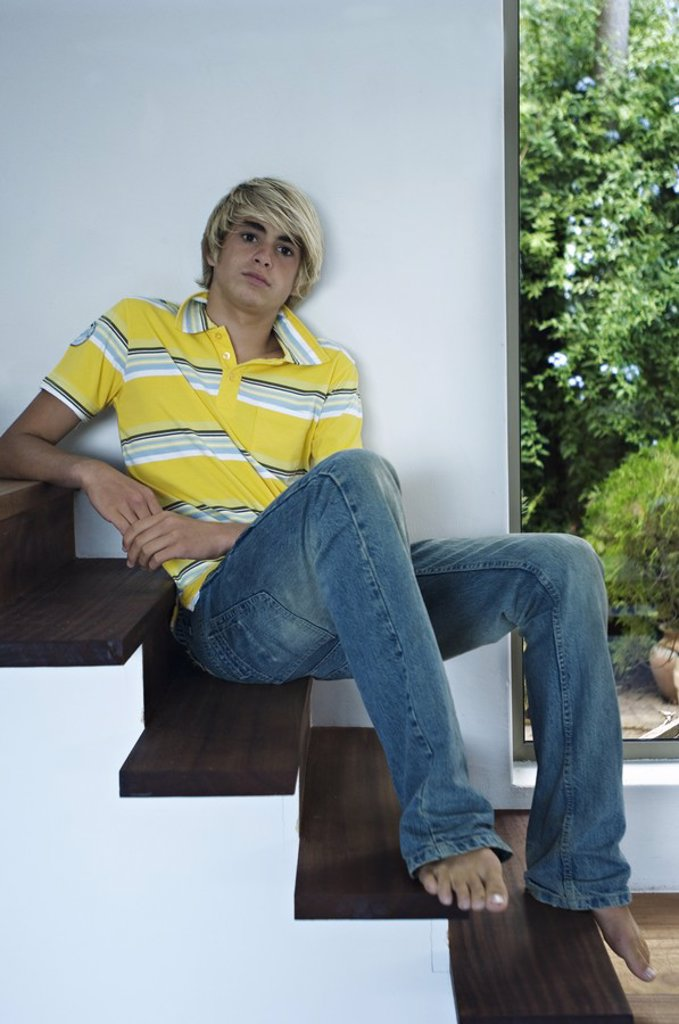 Teenage boy sitting on stairs : Stock Photo