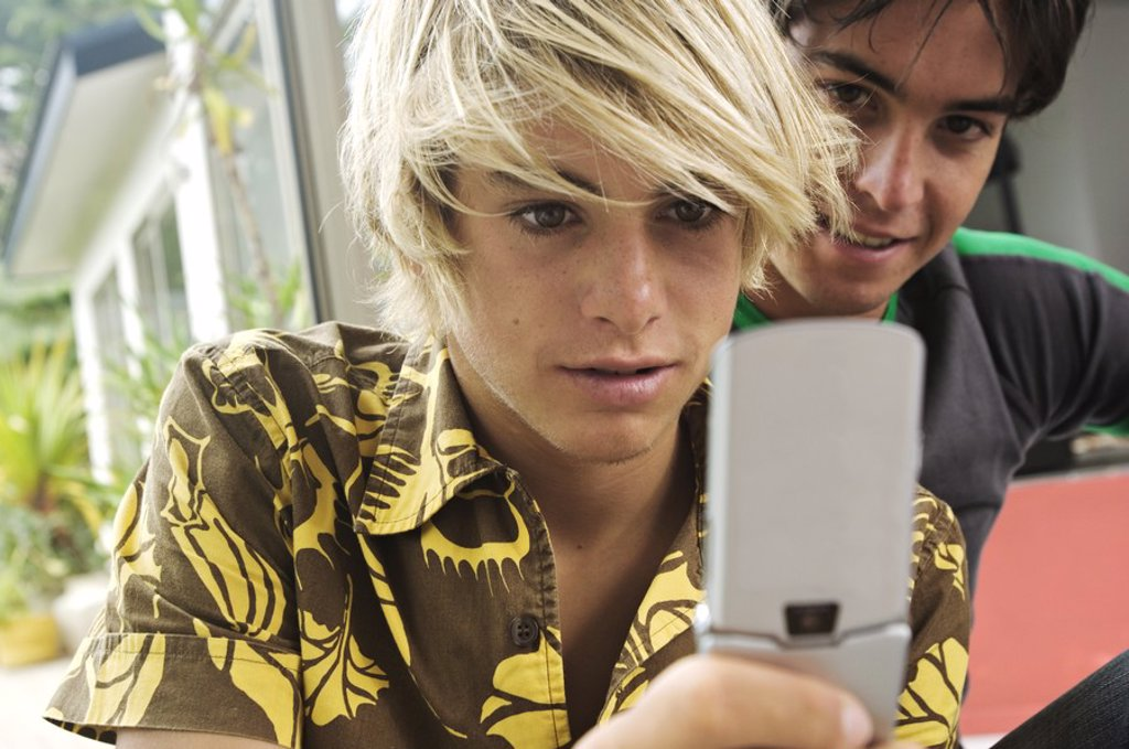 Stock Photo: 1738R-3201 2 teenage boys using mobile phone