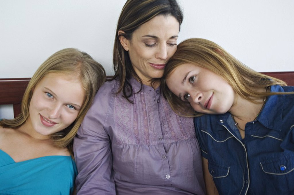 Stock Photo: 1738R-3214 2 teenage girls leaning on woman´s shoulders
