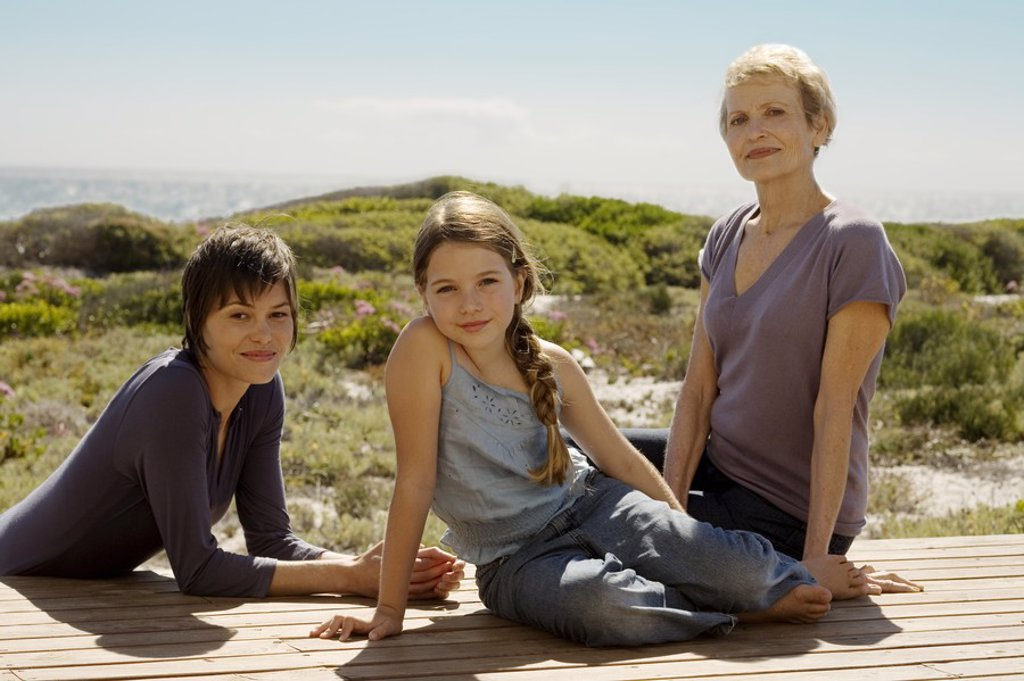 Female members of three generation family looking at camera, outdoors : Stock Photo
