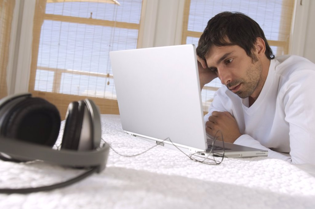 Stock Photo: 1738R-4098 Young man using laptop