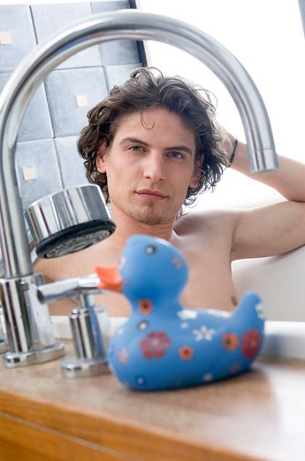 Man having a bath, looking at the camera : Stock Photo