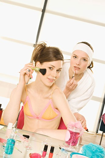 2 young women making up : Stock Photo