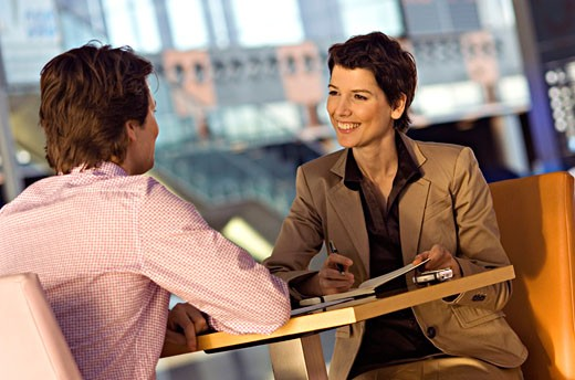 Businessman and a businesswoman in a meeting : Stock Photo