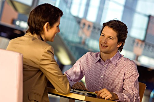 Stock Photo: 1738R-7630 Businesswoman and a businessman in a meeting
