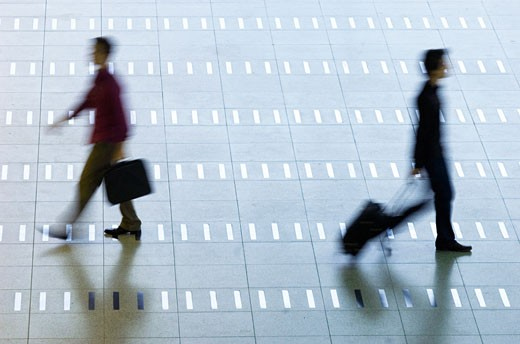 High angle view of two men walking at an airport lobby : Stock Photo