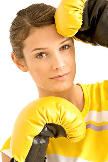 Portrait of a female boxer wearing boxing gloves : Stock Photo