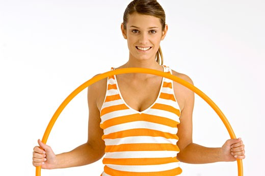 Stock Photo: 1738R-8035 Portrait of a young woman holding a plastic hoop