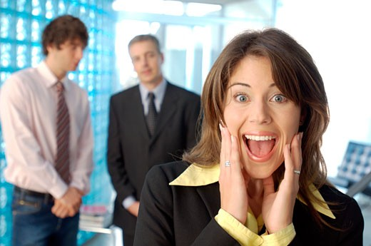Businesswoman screaming with colleagues in background : Stock Photo