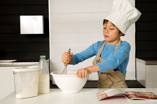 Stock Photo: 1738R-9237 Boy making a cake