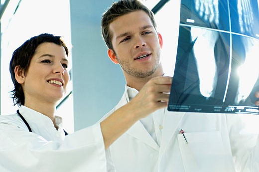 Stock Photo: 1738R-9721 Close_up of two doctors examining an X_Ray report