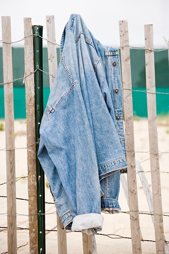 Jacket hanging on a fence : Stock Photo