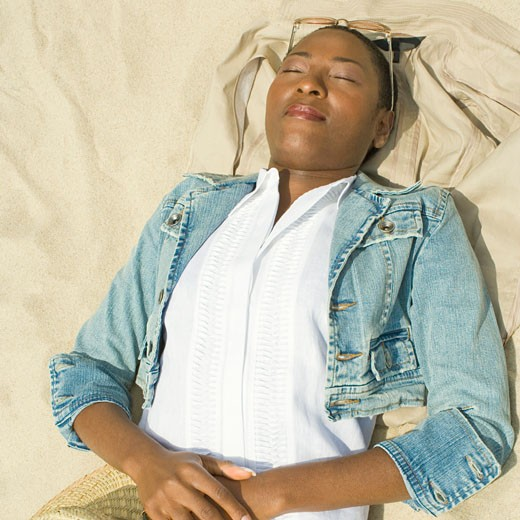 Stock Photo: 1741R-10758 High angle view of a mid adult woman sleeping on the beach