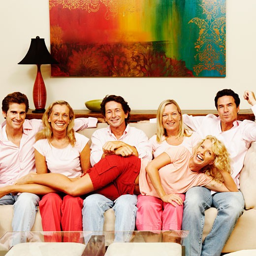 Stock Photo: 1741R-2010 Portrait of a group of people sitting together on a couch