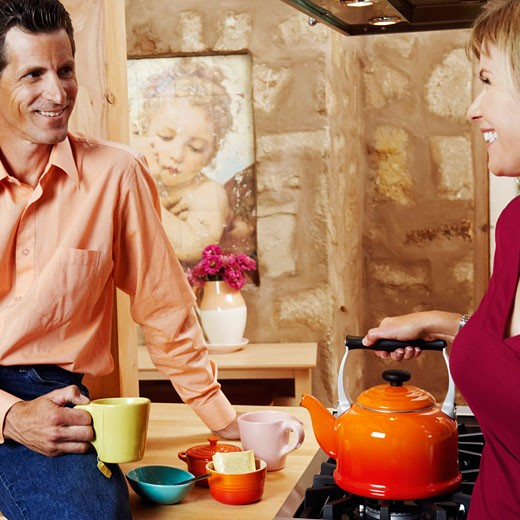 Stock Photo: 1741R-2065 Mature couple smiling in the kitchen