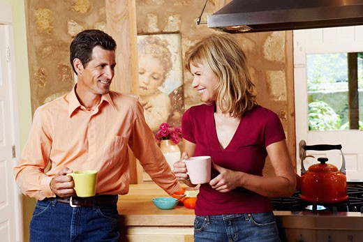 Stock Photo: 1741R-2068 Mature couple smiling and holding cups