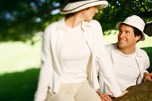 Close-up of a mid adult couple looking at each other and smiling : Stock Photo