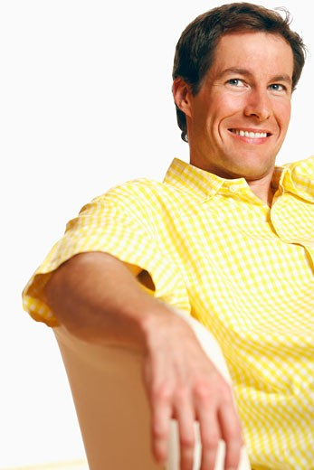 Close-up of a mid adult man looking away and smiling : Stock Photo