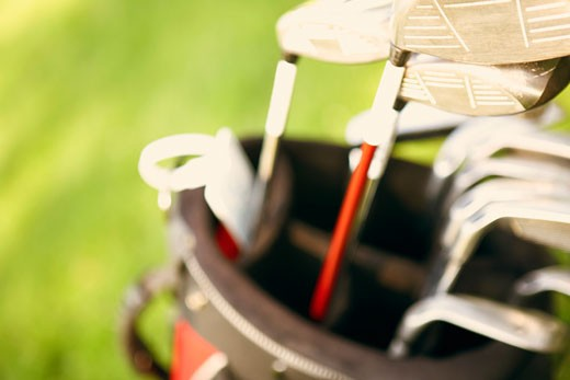 Close-up of golf clubs in a golf bag : Stock Photo