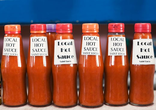 Stock Photo: 1741R-5960 Close-up of bottles of sauce in a row