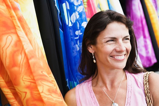 Stock Photo: 1741R-5972 Close-up of a mid adult woman smiling at a clothing store